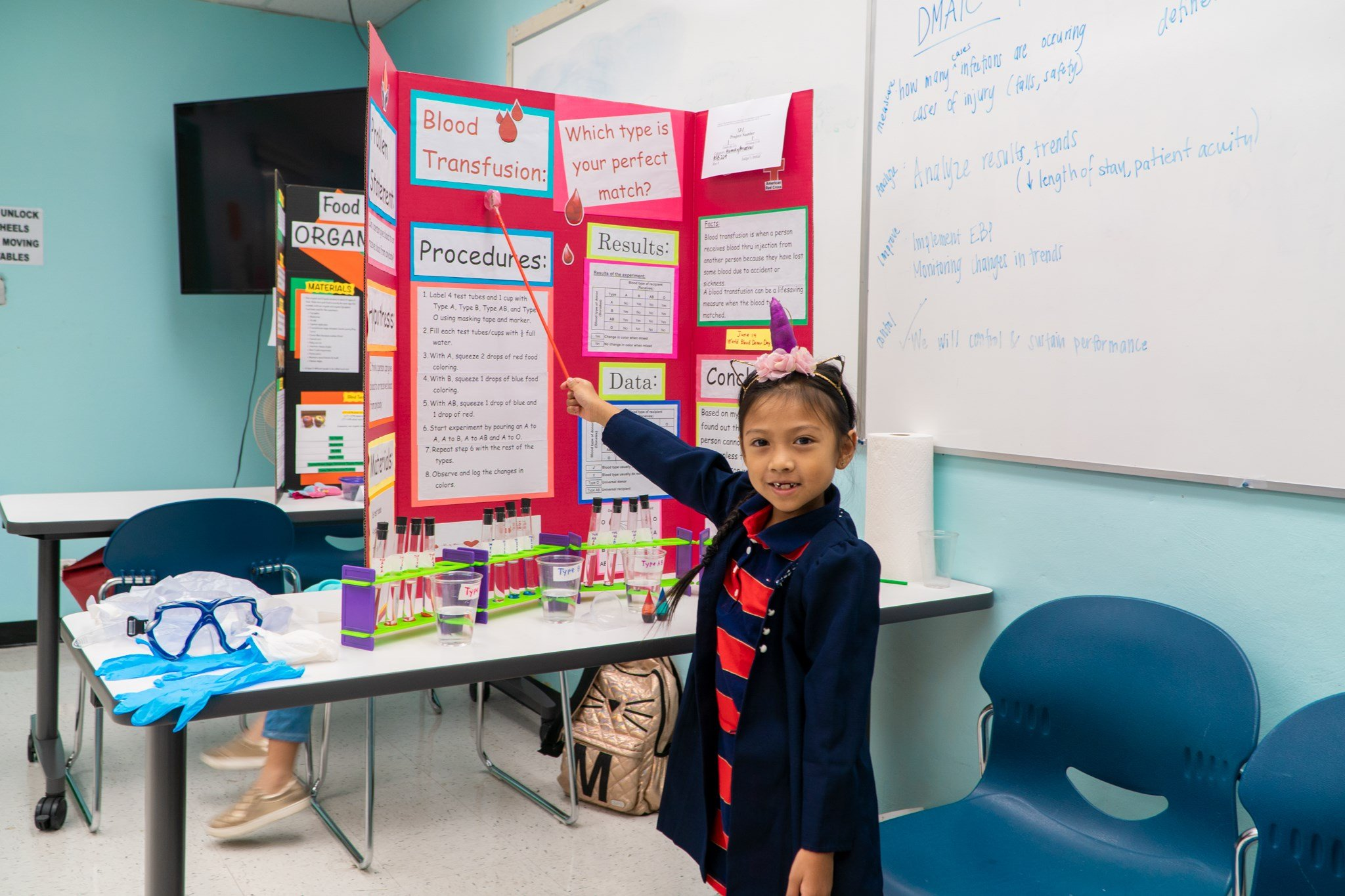 """Xylah Limtuatco of Machananao Elementary School, with her project: """"Blood Transfusion: Which Type is Your Perfect Match?"""""""